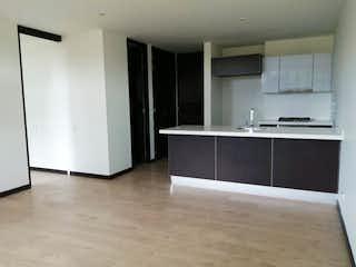Una cocina con nevera y fregadero en Apartamento en venta Ubicado en Rincón del Chico