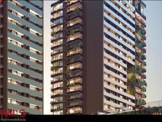 Un edificio alto sentado al lado de un edificio alto en Distrito Vera