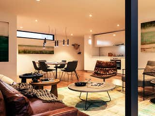 Una sala de estar llena de muebles y una televisión de pantalla plana en Eon
