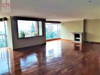 Una sala de estar llena de muebles y una televisión de pantalla plana en APARTAMENTO VENTA EN REFUGIO BOGOTA