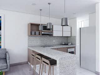 Una cocina con lavabo y microondas en Matisse