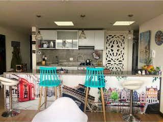 Una sala de estar llena de muchos muebles en VENTA APARTAMENTO CEDRITOS -BOGOTA
