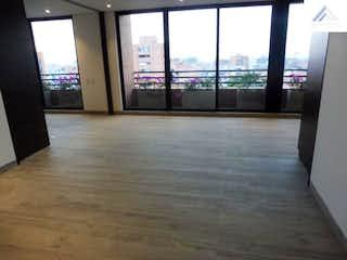Una vista de una habitación con una puerta corredera de cristal en Apartamento en Venta en Nogal - Balcón, 2 Habitaciones