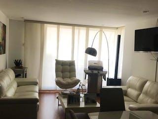 Una sala de estar llena de muebles y una televisión de pantalla plana en Apartamento En Venta En Bogota Chapinero Alto- 3 alcobas