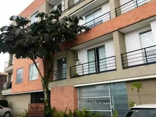 Un edificio con un árbol delante de él en Venta de Apartaestudio - Chia - Edificio Pradilla Reservado