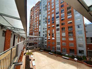 Una calle de la ciudad llena de edificios y una calle en Apartamento en venta en Caobos Salazar de 118m² con Bbq...