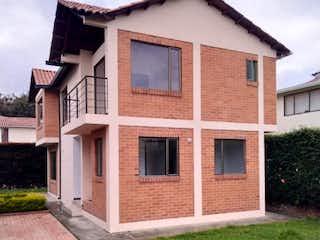 Un edificio de ladrillo con una ventana grande en él en Casa en venta en Casco Urbano Cajicá de 4 habitaciones