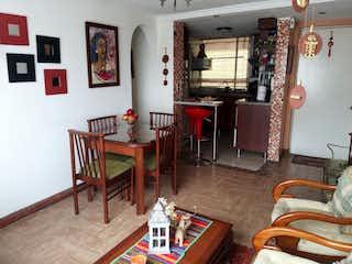 Una sala de estar llena de muebles y una chimenea en Apartamento en venta en Barrio Teusaquillo con acceso a Zonas húmedas