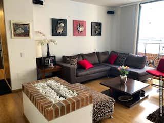 Una sala de estar llena de muebles y una televisión de pantalla plana en Lindo apartamento santa Paula 145m2-3 habitaciones