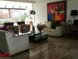 Una sala de estar llena de muebles y una televisión de pantalla plana en Mirador De San Angel