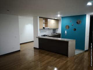 Una cocina con un fregadero y un horno de cocina en Apartamento en venta, La liberia-Usaquén, cuenta con Tres Habitaciones