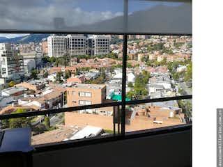 Una vista del horizonte de la ciudad desde una ventana en Apartamento en venta, Usaquén, cuenta con 3 habitaciones.