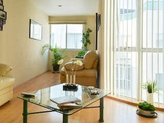 Una sala de estar llena de muebles y una gran ventana en  Departamento en venta en Portales de 87mt2