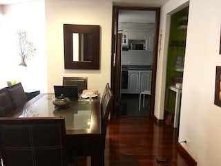 Una sala de estar llena de muebles y una televisión de pantalla plana en Apartamento En Venta En Bogotá Cedro Golf-Usaquén