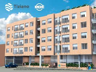 Un edificio con un gran edificio en el fondo en Tiziano