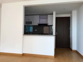 Un refrigerador congelador blanco sentado dentro de una cocina en Apartamento para Venta en Hayuelos
