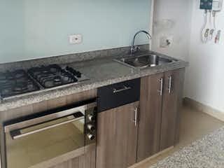 Una cocina con una estufa y un fregadero en Apartamento en Venta PRADO PINZON