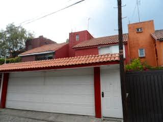 Un edificio de ladrillo rojo con un techo rojo en SAN JERONIMO ACULCO