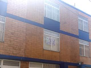 Un gran edificio de ladrillo con una gran ventana en Casa en venta en El Tintal de 3 hab. con Jardín...
