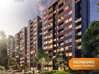 Un edificio alto sentado al lado de un edificio alto en Apartamento en venta en Estadio / Terminal de 2 alcobas