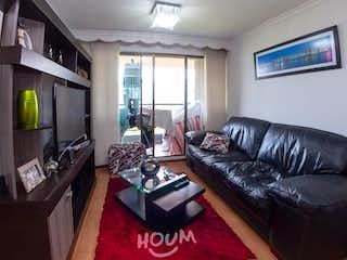 Una sala de estar llena de muebles y una televisión de pantalla plana en Apartamento en venta en San Antonio Norte, 84mt