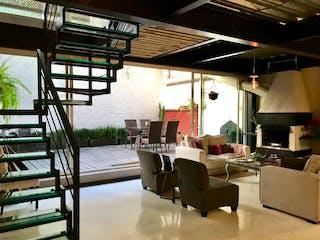 Una sala de estar llena de muebles y una gran ventana en Departamento en venta en Lomas de Chapultepec de 228 mt2. con terraza.