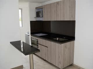 Una cocina con un fregadero y una estufa en Montecarlo 168