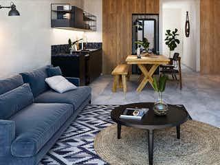 Una sala de estar llena de muebles y una televisión de pantalla plana en INARA Hábitat Guadalupe
