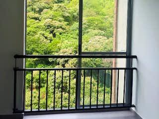 Una ventana que está en una habitación en Apartamento de 38m2 en La Estrella, Sector Tablaza