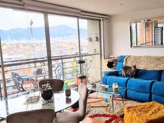 Una sala de estar llena de muebles y una ventana en Apartamento en venta en Nueva Marsella, 67mt