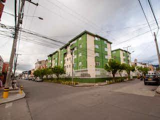 Una calle con coches estacionados en su costado en Apartamento en venta en Prado Veraniego de 1 hab.