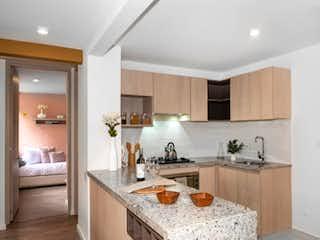 Una cocina con una estufa de fregadero y armarios en Senderos de Modelia