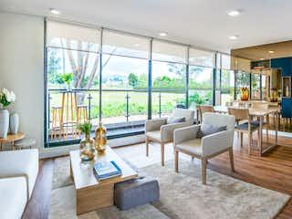 Una sala de estar llena de muebles y una gran ventana en Nogal