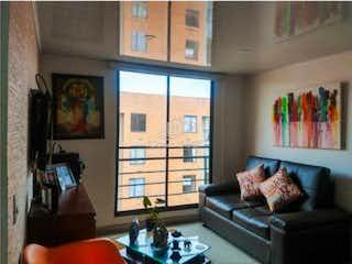 Una sala de estar llena de muebles y una ventana en Venta Apartamento en Conjunto Residencial El Prado - Hacienda Madrid