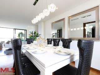 Un comedor con una mesa y sillas en Mondrian