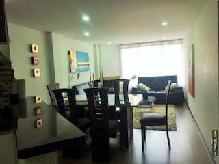 Una sala de estar llena de muebles y una televisión de pantalla plana en Venta de apartamento en Bella Suiza, Bogotá, cuenta con 2 habitaciones.