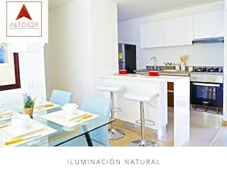 Una cocina con una mesa y una mesa en Altos 29