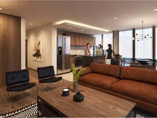 Una sala de estar llena de muebles y una televisión de pantalla plana en SENNSE Garden Condesa