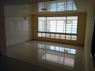 Una ventana que está abierta en una habitación en Casa En Venta En Bogota Modelia - 4 alcobas