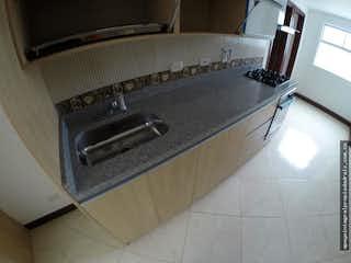 Una estufa encima del horno sentado dentro de la cocina en  Apartamento en Jardines de la Católica - 3 Habitaciones