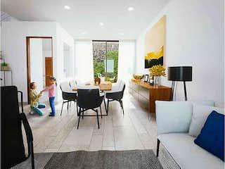 Una sala de estar llena de muebles y una televisión de pantalla plana en Spazio Coyoacán II