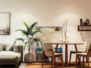 Una sala de estar llena de muebles y una planta en maceta en Cuauhtémoc 710