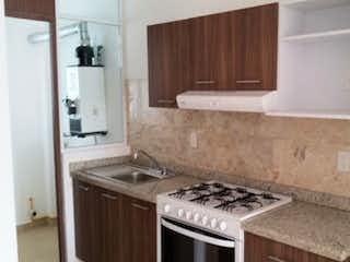Una cocina con una estufa y un fregadero en Departamento en venta en Alamos 80 m2 con 2 estacionamientos