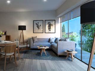 Una sala de estar llena de muebles y una mesa en Torre Lago