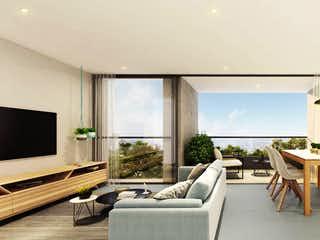 Una sala de estar llena de muebles y una televisión de pantalla plana en Tierra Grata Bruja Mágica