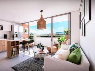 Una sala de estar llena de muebles y una gran ventana en Distrito plaza