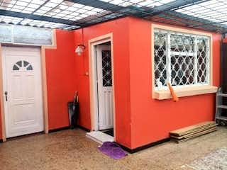 Un refrigerador congelador rojo sentado dentro de una cocina en Casa En Venta En Bogotá Capellania