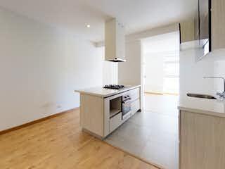 Una cocina con una estufa blanca encima del horno en Smart 135
