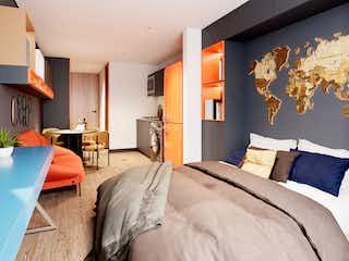 Una habitación de hotel con una cama y un televisor en Héroes 79St Torre 3
