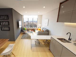 Una cocina que tiene una mesa y sillas en ella en VOU